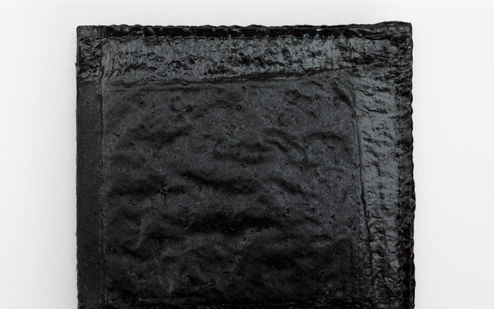 sealed barrier side of McAllister Mills' absorbent mat