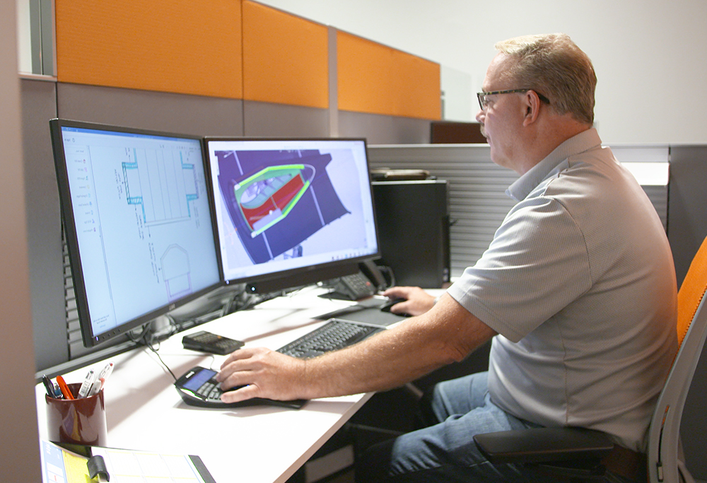 McAllister Mills thermal expert working on a CAD drawing